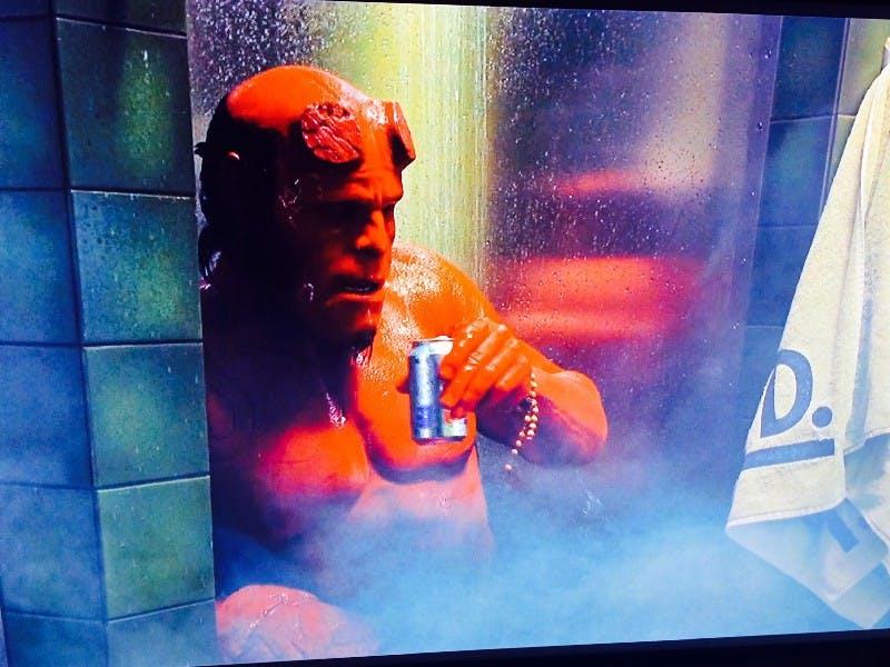 Hellboy enjoying a shower beer.